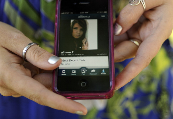 29-year-old Allison Silva uses the phone app HowAboutWe to meet people for dating. She was at an Aurora Park on Thursday, September 22, 2011. Cyrus McCrimmon, The Denver Post