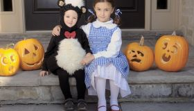 Brother and Sister Dressed for Halloween Sitting on a Step, Toronto, Ontario