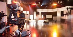 Empty television studio with camera
