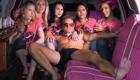 Five women and stripper in limousine