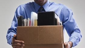 Businessman holding a box of office supplies