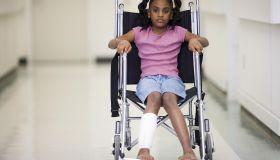 African American girl sitting in wheelchair
