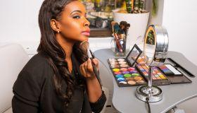 African American Woman Doing Makeup