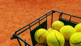 High Angle View Of Yellow Tennis Balls In Basket.