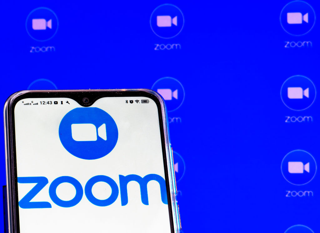 In this photo illustration a Zoom Video Communications, Inc...