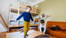 Two little boys playing in their room