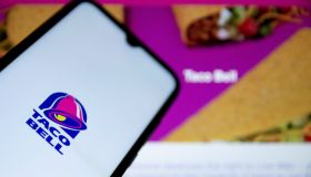 In this photo illustration a Taco Bell logo seen displayed...