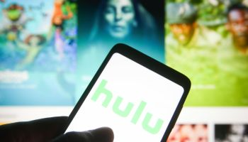 In this photo illustration a Hulu logo is seen on a...